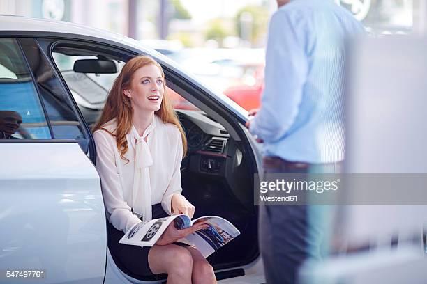 Car dealer talking to client