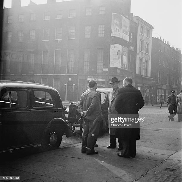 Car dealers discuss business in Warren Street London November 1949 Warren Street was one of the oldest street car markets in Britain Original...