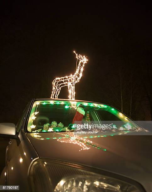 car decorated with christmas lights and decorations, night time - christmas decoration stock pictures, royalty-free photos & images