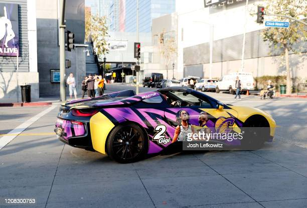 A car decorated with images of Kobe Bryant and Gigi Bryant are seen outside Staples Center on February 23 2020 in Los Angeles California
