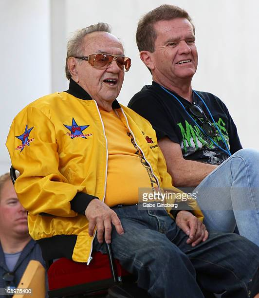 Car designer George Barris and actor Butch Patrick arrive at the opening ceremony of Las Vegas Car Stars at the Fremont Street Experience on May 17...