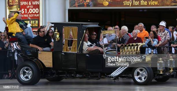 Car designer George Barris and actor Butch Patrick arrive in the Munster Koach from the television series The Munsters at the opening ceremony of Las...