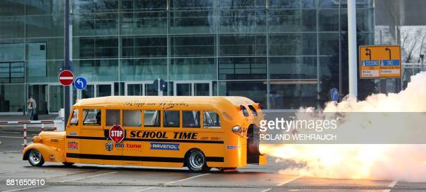Car designer Gerd Habermann launches his 'School Bus Jet' vehicle during a preview of the Essen Motor Show on November 29 2017 in Essen western...