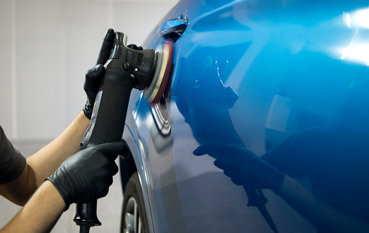 Car detailing concept. Auto cleaning and polish. 1058523224