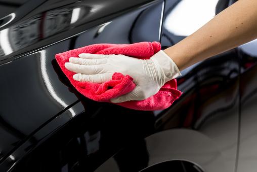 Car detailing series : Cleaning black car 534047498