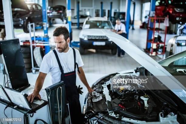 car diagnostics in a repair shop! - computer repair stock pictures, royalty-free photos & images