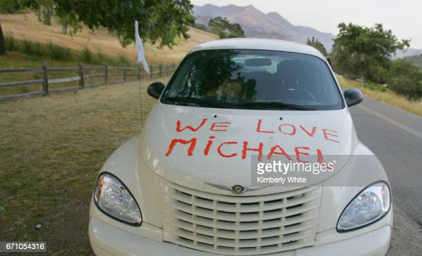 """Car displaying a sign """"We Love Michael"""" sits in front of pop star Michael Jackson' Neverland Ranch in the hills near the town of Los Olivios. Fans..."""