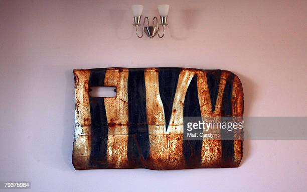 A car door is displayed John Chalmers living room wall which he is saved from a wrecked car that was left in a quarry and painted by the guerrilla...