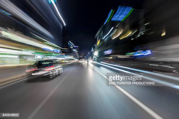 car driver POV - onboard a car - long exposure - Cape Town 2017 - shot-20: driving nights through the city / blurred black limousine in foreground