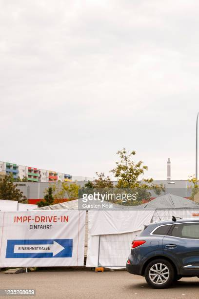 Car driver waits at a drive-in vaccination station in an IKEA car park on the third day of the #HierWirdGeimpft Covid-19 vaccination campaign on...