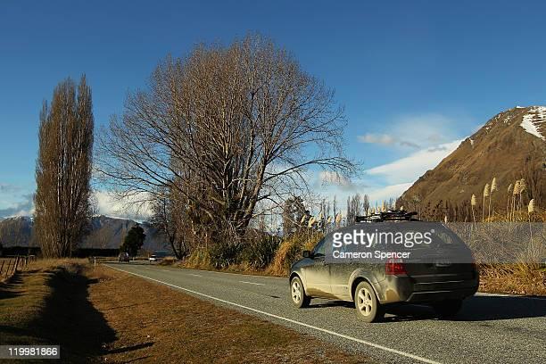 A car drives along Mt Aspiring road on July 28 2011 in Wanaka New Zealand