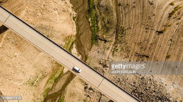 Car drives along the Enterprise Bridge while passing over Lake Oroville in Oroville, California on September 5, 2021. - Lake Oroville is currently at...