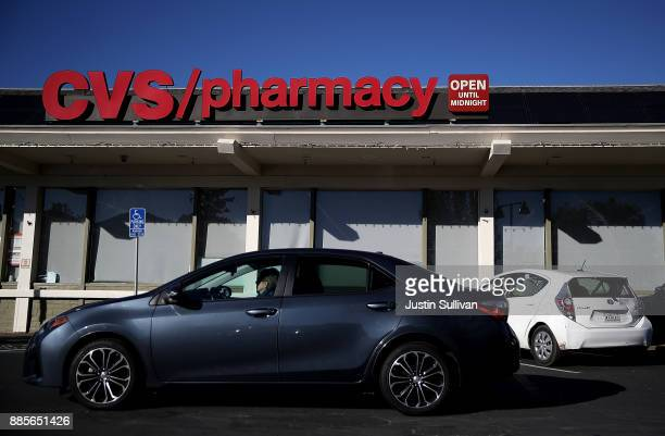 A car drives by a CVS Pharmacy on December 4 2017 in San Anselmo California Drugstore chain CVS Health Corp announced plans on Sunday to acquire...