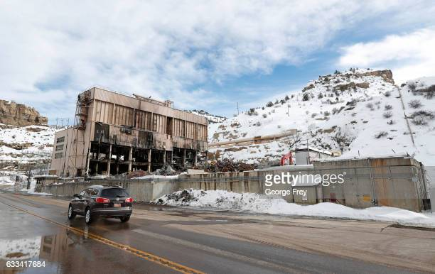 A car drives by as crews dismantle PacifiCorp's coalfired Carbon Power Plant on February 1 2017 in Helper Utah The 62yearold 173megawatt plant was...