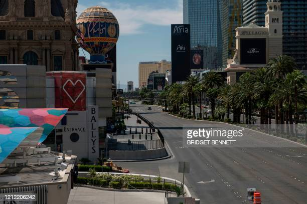Car drives down an otherwise empty Las Vegas Strip amid the novel coronavirus pandemic on May 8, 2020 in Las Vegas, Nevada. - In the absence of...