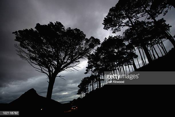 A car drives down Signal Hill towards Devil's Peak at dusk on June 15 2010 in Cape Town South Africa