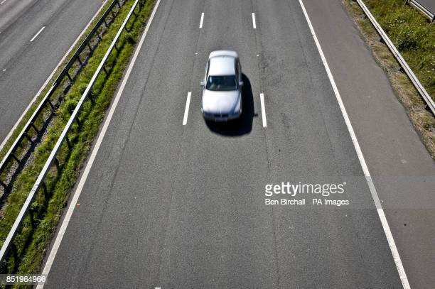 A car drives in the middle lane of the M5 Motorway near Bridgend Wales
