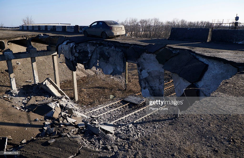 A car drives on a partly blown up bridge on February 20, 2015 in Debaltseve, Ukraine. The strategic railway town of Debaltseve is of under the control of pro-Russian rebel fighters, after Ukrainian Government forces began to withdraw from the town early on Wednesday, after heavy fighting.