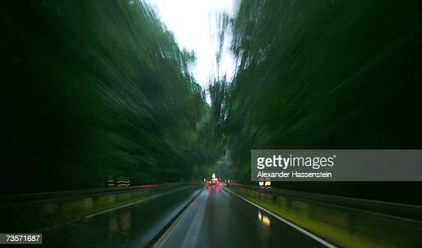 A car drives on a wet street on February 5 2007 near Hanover Germany Germany is currently in a heated debate over the future of traffic and travel in...