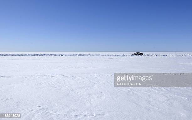 A car drives on an ice road to small island Kihnu in southwestern Estonia on March 18 2013 Spring may be around the corner but in Estonia residents...