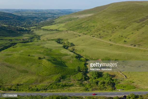 Car drives on the A470 at the Brecon Beacons on June 23, 2020 in Brecon, United Kingdom. National parks and beauty spots remain closed in Wales as...