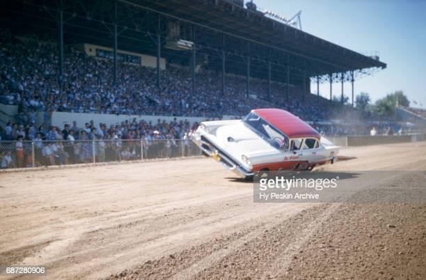 A car drives on two tires during a car show at the Sacramento State Fair circa August 1958 in Sacramento California