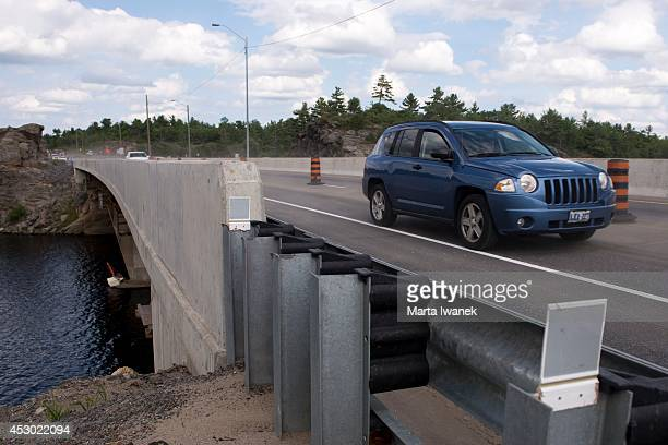 GRAVENHURST ON JULY 31 A car drives over the Gull Lake Narrows bridge which is soon to be fully open after two years of construction in Gravenhurst...