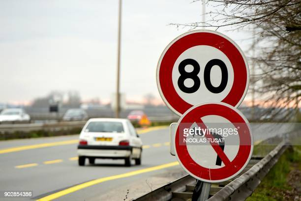 A car drives past a road sign indicating a speed limit of 80 km/h on a road near Bordeaux southwestern France The French government announces on...