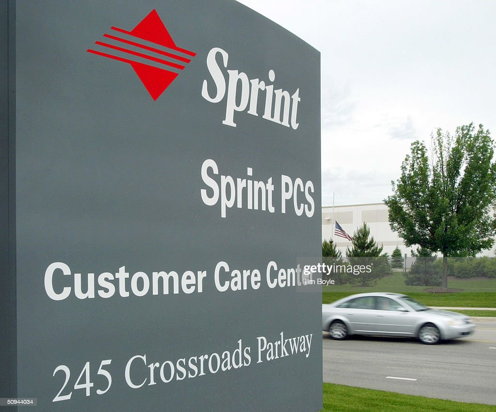 A Car Drives Past A Sign For The Sprint Customer Care Center June 9, 2004  Sprint Customer Care
