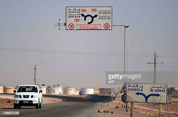 A car drives past an oil installation on the outskirts of In Amenas deep in the Sahara near the Libyan border on January 18 2013 Islamist...