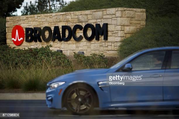 A car drives past signage displayed outside of Broadcom Ltd headquarters in Irvine California US on Monday Nov 6 2017 Broadcom Ltdand its advisers...