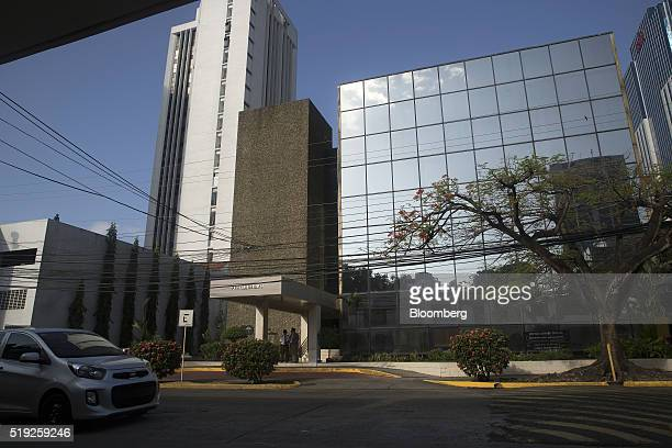 A car drives past the building housing the offices of the Mossack Fonseca law firm in Panama City Panama on Tuesday April 5 2016 For decades Jurgen...