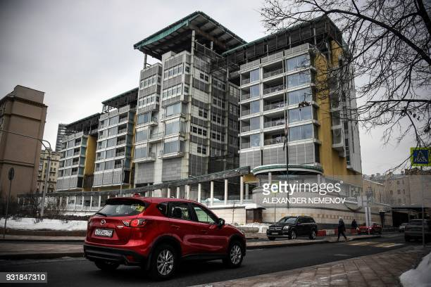 A car drives past the buildings of the British embassy in Moscow on March 14 2018 Britain will expel 23 Russian diplomats over the nerve agent attack...