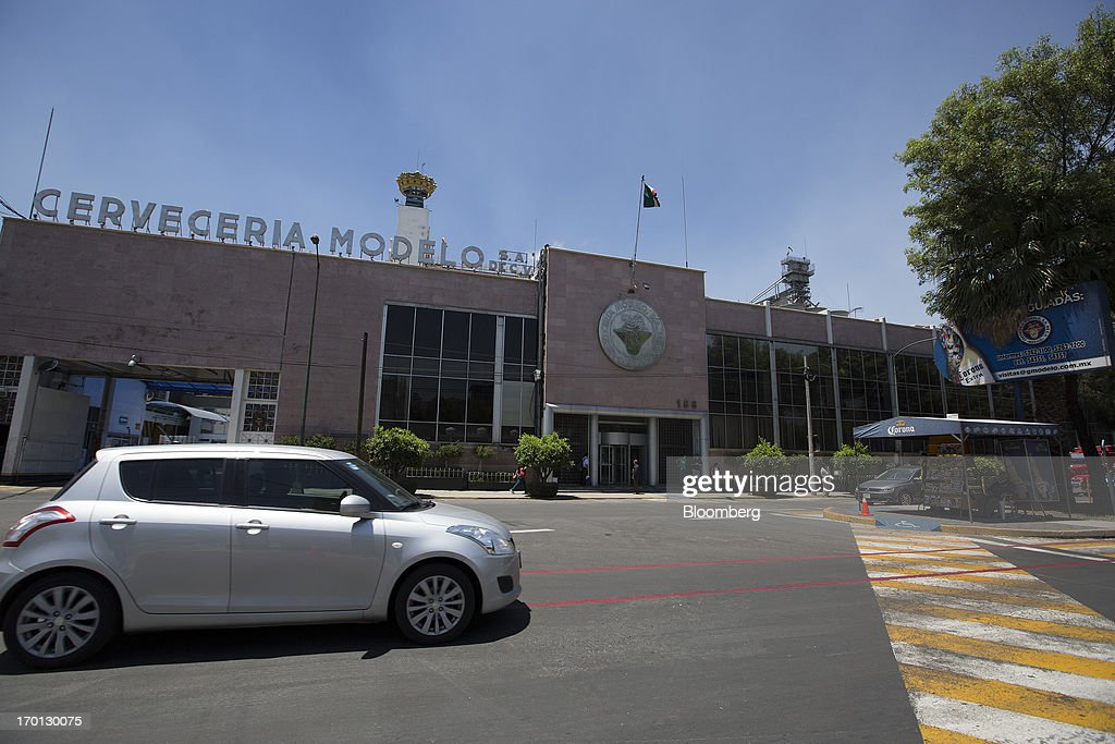 A car drives past the Grupo Modelo SAB brewery in Mexico City, Mexico, on Thursday, June 6, 2013. Heineken NV and Grupo Modelo SAB, the dominant brewers in Mexico with brands such as Dos Equis and Corona, are nearing the end of an almost three-year-old government antitrust probe. Photographer: Susana Gonzalez/Bloomberg via Getty Images