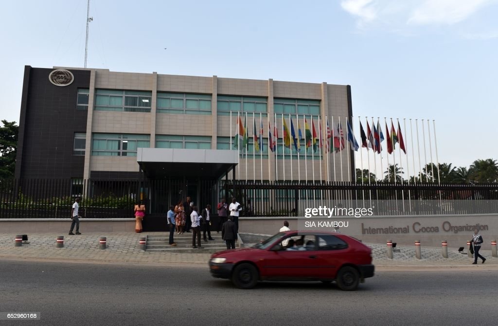 A car drives past the new headquarters of the International Cacao Organization (ICCO) in Abidjan on March 13, 2017, ahead of a visit by the ICCO chairperson. The headquarters of the ICCO, based in London for over half a century, will be relocated to Abidjan, the world's largest cocoa producer. / AFP PHOTO / Sia KAMBOU