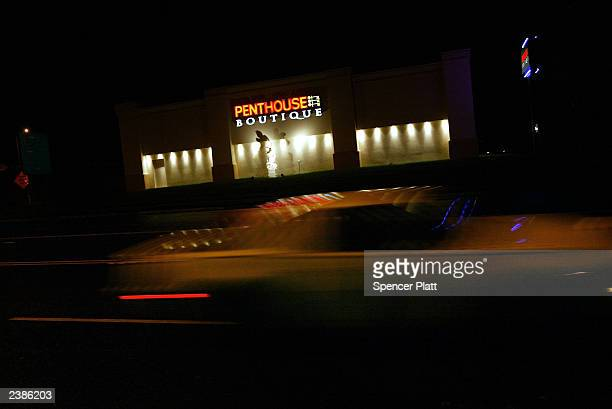 A car drives past the Penthouse Boutique is shown August 10 2003 in Milford Connecticut The Penthouse Boutique which is not owned by the financially...