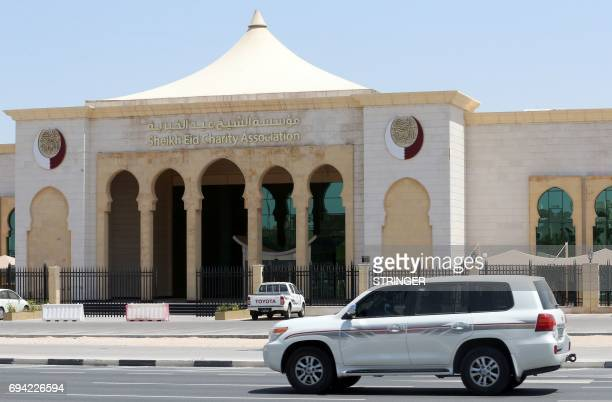A car drives past the Sheikh Eid Charity Association in the Qatari capital Doha on June 9 2017 Saudi Arabia Egypt the UAE and Bahrain announced on...