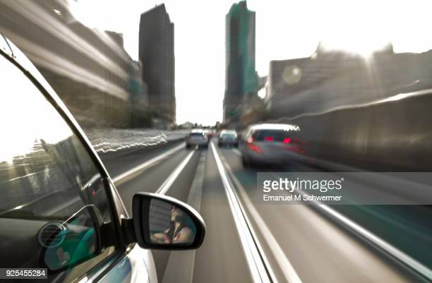 car drives through berlin while sunny day - long exposure - transportation occupation stock pictures, royalty-free photos & images
