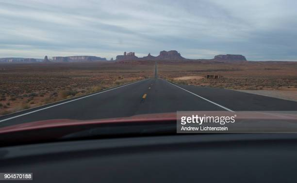 A car drives through Monument Valley on December 31 2017 in Arizona's Navajo Reservation