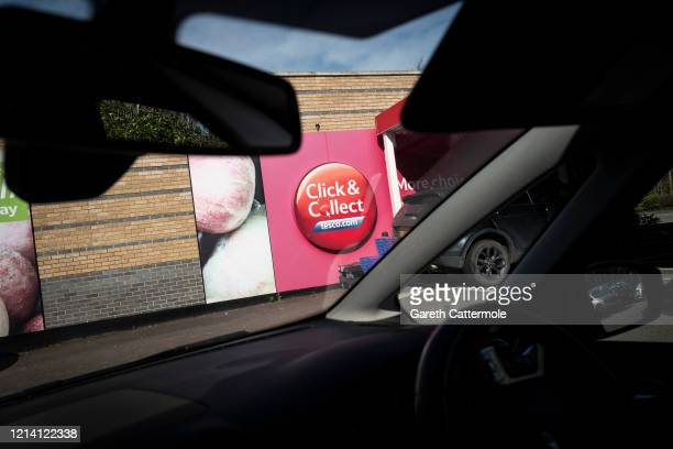 A car drives up to a Tesco Click Collect pick up point as social distancing to stop the spread of the coronavirus prompts different ways of shopping...