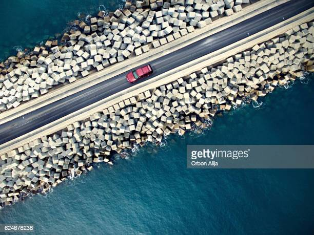 Car driving along the coastline