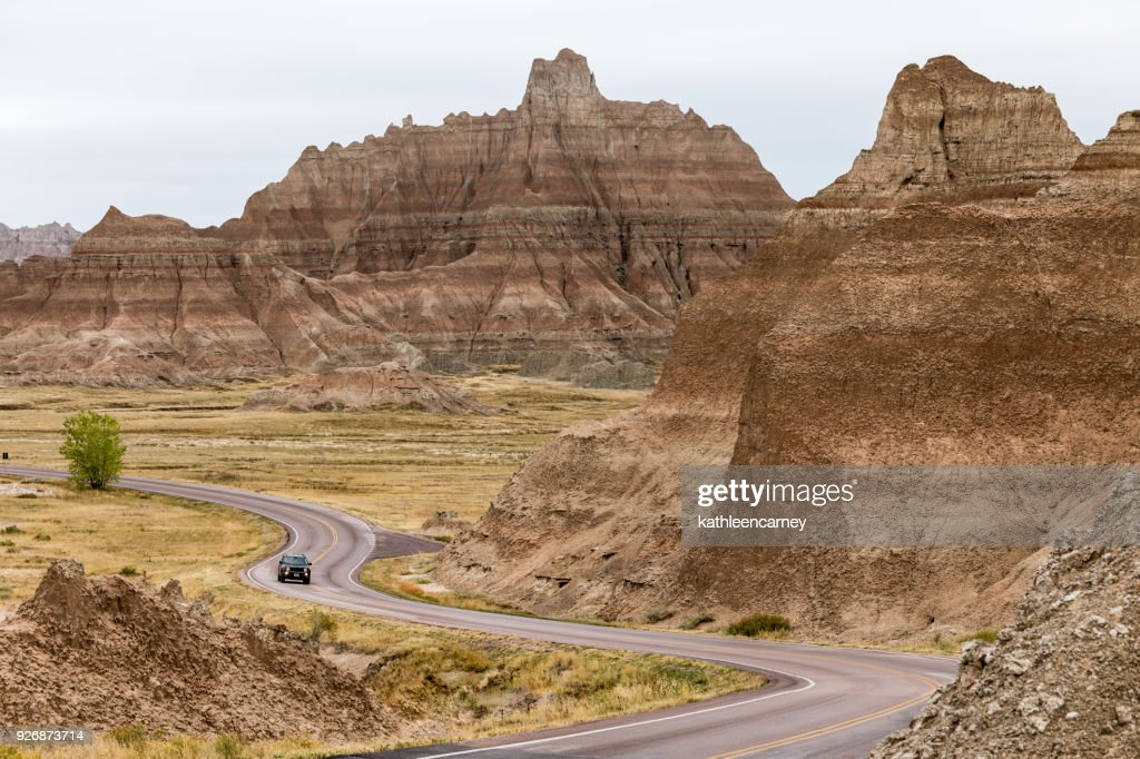 Car Driving along winding road, Badlands National Park, South Dakota, America, USA : Stock Photo