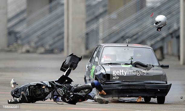 A car driving at 70 km/h hits a dummy on a scooter on October 2 2012 in Le Mans during a crash test organized to raise awareness of high school...