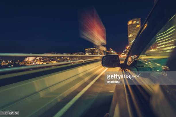 car driving at night in downtown sydney