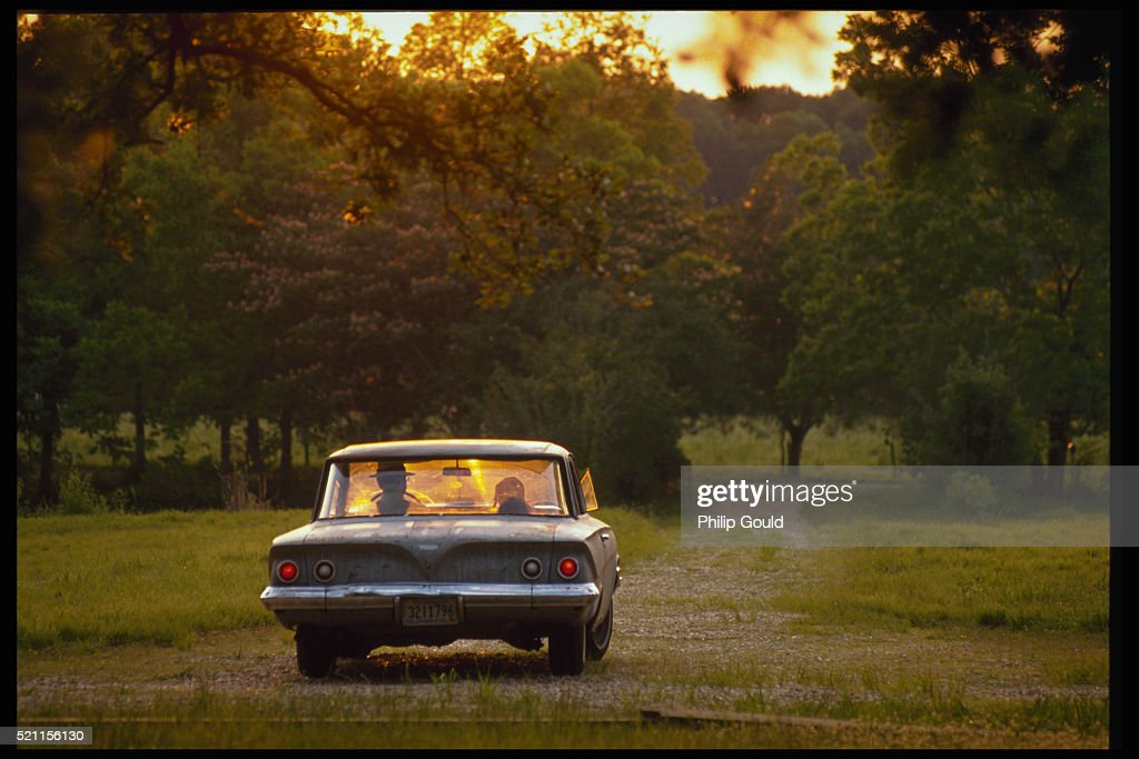 car driving away stock photo getty images