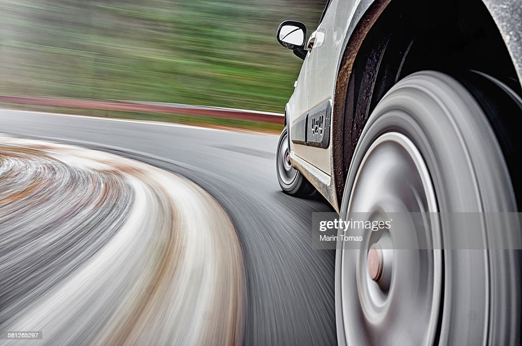 Car driving fast : Stock Photo