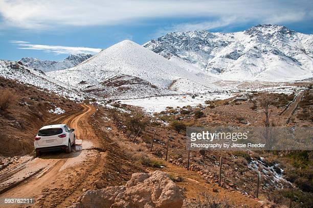 Car driving from the desert into the snow