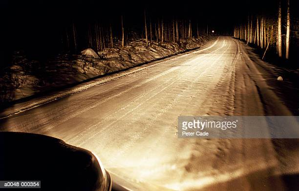 Car Driving in Snow at Night