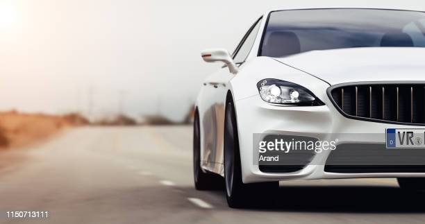 car driving on a road - car stock pictures, royalty-free photos & images