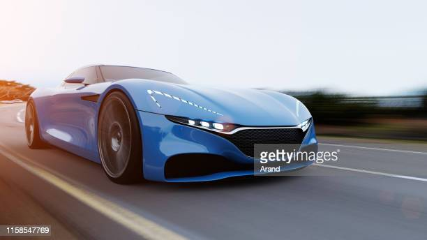 car driving on a road - sports car stock pictures, royalty-free photos & images